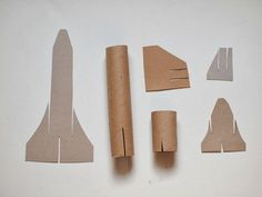 """Space Shuttle Craft (template included) Flying Cardboard Roll space shuttle craft that """"flies""""!Flying Cardboard Roll space shuttle craft that """"flies""""! Cardboard Rolls, Cardboard Crafts, Cardboard Rocket, Space Party, Space Theme, Diy For Kids, Crafts For Kids, Arts And Crafts, Space Shuttle Challenger"""