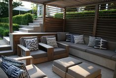 Formal Structural Garden | Shaded seating area within timber arbour | Charlotte Rowe Garden Design