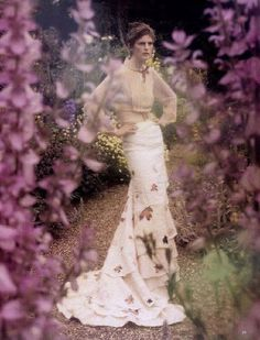 TIM WALKER EDITORIAL SHOOT IDEA FLOWERS IN FOREGROUND, DRESS IN BACKGROUND