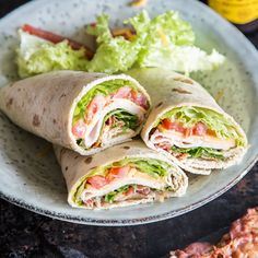 Great roll on the go: ham and cheese wraps with Tolle Rolle für unterwegs: Schinken-Käse-Wraps mit Bacon The classic among wraps: the popular combination of spicy cooked ham and creamy yellow cheddar. As a little extra, there is crispy bacon on top. Cheese Wrap, Ham And Cheese, Sandwich Recipes, Snack Recipes, Healthy Recipes, Healthy Food, Food To Go, Food And Drink, Avocado Dessert