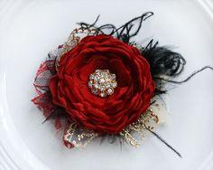 Flor del pelo negro y oro rojo