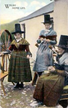 A group of women in Welsh National Costume. One is knitting and the other two are spinning yarn. What do I have to do to get a hat? Spinning Wool, Hand Spinning, Spinning Wheels, Folk Costume, Costumes, Welsh Lady, Knit Art, Art Du Fil, Paper Crafts Origami