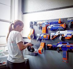 My 11 year old has been pinning nerf gun walls the past year...his dream came true today! Seriously, if I knew this made him this happy...I would have done this a while ago! Not only that, but all his guns have been packed away. So to see them all together AND organized beautifully (he takes after his mother in the beautiful organization thing) he's in heaven!! This wall was SO easy you guys!! Seriously... we spray painted an off the shelf peg board from lowes, picked up some peg board…