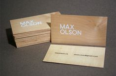 Max Olson wood veneer business cards with white ink print finish.