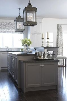 gray kitchen design idea 70-I like the two tiered island....lower section great place for small appliances or party ware...or cookbooks