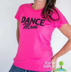 Show your DANCE MOM pride in this 100% cotton tee with your choice of shirt style, shirt color, and glitter color.