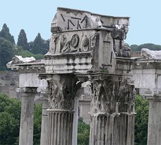 columns of the Temple of Vespasian; Roman, first century CE The photo was taken from the corridor of the Tabularium and shows the Corinthian capitals and entablature frieze depicting religious implements. Rome, Roman Forum. vesp_columns.jpg 400×362 pixels