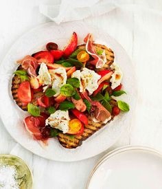 Tomato, prosciutto, peach, basil and mozzarella salad on bruschetta recipe | Salad recipe - Gourmet Traveller
