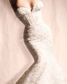 """See the """"Curves Ahead"""" in our 11 Head-Turning Wedding Gowns That Show Off Your Best Feature gallery"""