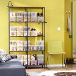 Great room from IKEA. This set-up would also be a great for a craft room. The utilitarian containers neutralizes the easy-access display and refocuses our attention on the decor.
