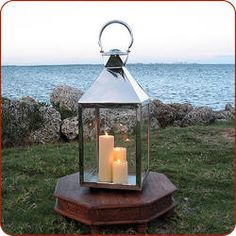 "Lantern,Moroccan lantern, Moroccan lighting Measures 32"" high x 12"" wide Candles not included Double encased and rounded handles allow comfortable carrying Large hinged panel opens and allows for fairly large candles This lantern is made of stainless steel and will not rust This lantern style is a South Beach favorite and can be seen all over at The Shore Club"