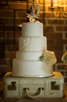 Vintage lace wedding cake on a suitecase by Intricate Icings, Photos by Adam and Imthiaz