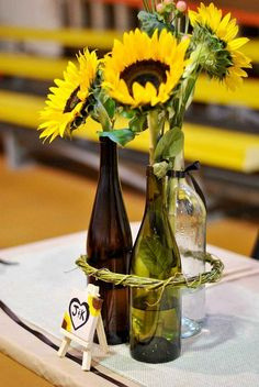 Another great DIY centerpiece idea! Sunflowers look elegant and bright in these wine bottles. Shop sunflowers (petite and regular!) year-round at GrowersBox.com!