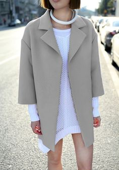 Love the structured wool coat and rolled leather necklace!!!!!!!!!!