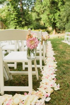 I would like to have mason jars hanging on the chairs like this with corral peonies and baby's breath in the jars. Cute and simple! Everybody does the flowers in a ball. Plus it will be cheaper.