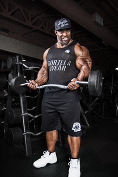 Gorilla Wear Athlete IFBB pro Cory Mathews wearing the Mesh Cap black, New York Mesh Tank Top and Oversized Athlete Shorts. The Mesh cap is also available in red.