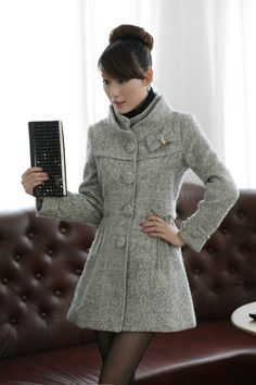 Light gray Fashion wool coat, autumn winter jacket coat, fitted jacket coat, charm warm coat jacket. $72.99, via Etsy.
