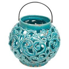 """Weathered ceramic lantern in turquoise with handle and ornate openwork detail.  Product: LanternConstruction Material: Ceramic and metalColor: TurquoiseAccommodates: (1) Candle - not includedDimensions: 8.3"""" H x 8.9"""" Diameter"""