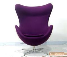 Arne Jacobsen - Egg chair. Modern, sleek, flowing. Love the color too. Clean lines with rounded edges.