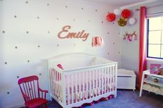 Bright coral girl's nursery with gold starburst accents.