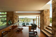 Delany House by Jorge Hrdina Architectsa Architects:Jorge Hrdina Architects Location:Seaforth, Sydney, Australia Year: 2012 Area: 8,020 sqft Photo courtesy:Brigid Arnott Description: The house for a family of five sits on a steep site, surrounded by eucalypts on Sydney's Middle Harbour. From the street, a low flying roof and strong, horizontal screen reveal little of the