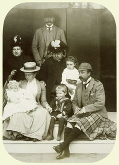 Photograph showing from left to right: Duchess of Connaught (seated) with Princess Patricia on her lap; Princess Beatrice seated behind Duchess of Connaught; Prince Henry of Battenberg; Queen Victoria, holding Princess Margaret; Prince Arthur; the Duke of Connaught (seated). September 1886.