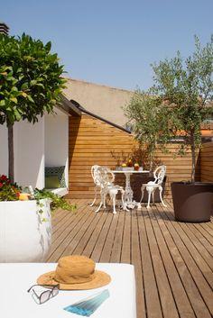 Dúplex familiar ubicado en Barcelona con un contrastes in and out chicanddeco