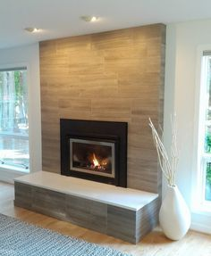 Modern Brick Fireplace; porcelain tile clad, solid surface slab on top. clean, simple, modern.