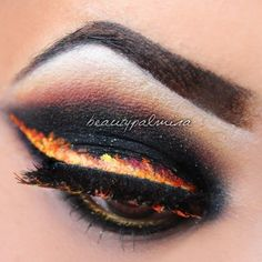 girl on fire eye makeup. It's very different