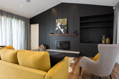Waiata open plan living with a standout feature wall. Wall, Home, Show Home, Sofa, Furniture, Open Plan, Open Plan Living, House, Feature Wall