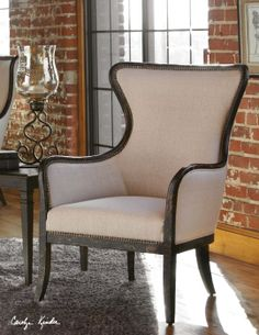 Sandy wing chair.  Weathered black finish on exposed wood.  www.swansfurniture.com