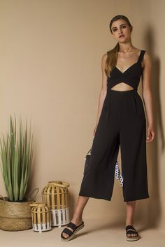 Jumpsuit with crop leg and cut out detail.