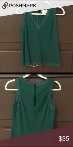 Lace detailed tank Green lace detailed v-neck tank. Lace detail at neck, sleeves, and bottom Skies Are Blue Tops Tank Tops