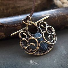 Wire wrapped brass necklace with pietersite gem Oxidized and polished ⊙ 40x30 mm // 1.57x1.18 inches ⊙ Cord included ⊙ Free shipping Items ships from Kharkiv (Ukraine) within 1-2 days of purchase. You will be informed about shipping with track number of package. If you have any questions please feel free to contact me _____________________________________________ Care instructions: - keep your jewelry in a dry dark place, and try to avoid contact with household chemicals and ...