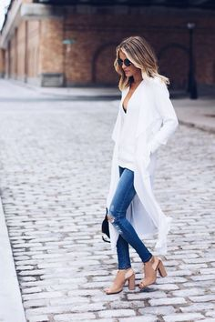 Super cute long white jacket with a white top and jeans with nude shoes! Such a cute outfit for a day running around town!