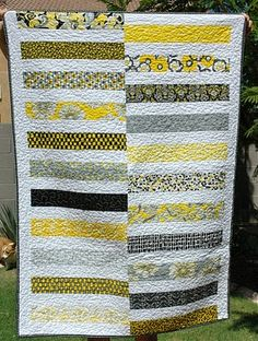 """Stripey quilt - a little too """"quilted"""" for me, but I like the pieces."""