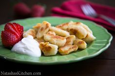 Cheese Dumplings Recipe | Traditional Ukrainian dumplings (aka Lazy Vareniki) are made with Tvorog; a homemade farmers cheese. This is an even lazier (I mean easier) version. The Ricotta cheese is inexpensive and simple. | http://natashaskitchen.com/2013/02/17/cheese-dumplings-recipe/