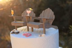 How cute is this? Beach themed wedding cake topper with mini Adirondack Chairs!