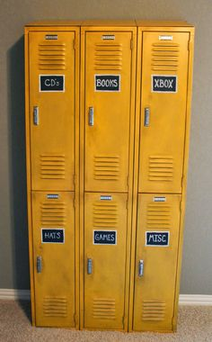 Antique lockers, painted with a glaze to tone down the bright yellow. Making it fit better in the vintage themed boys room. Chalkboard squares painted on each locker, labeling what is in each.  Theraggedwren.blogspot.com