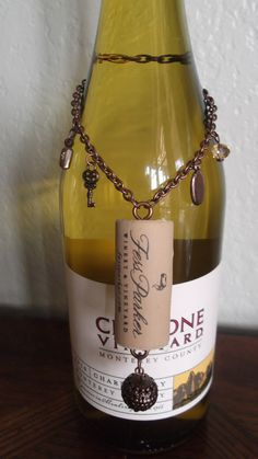 Recycled cork copper finish metal glass charm crystal wine bottle jewelry. $8.00, via Etsy.