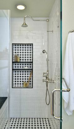 Glass door showers. Also, love that shower head and tiled shelf.