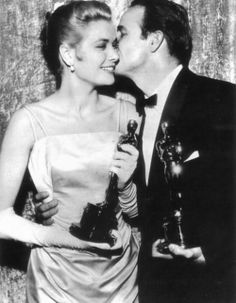 """Academy Awards, 1955. Marlon Brando, winner as best actor, kissing Grace Kelly, winner as best actress for """"The Country Girl""""."""