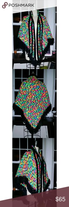 "Rainbow yarn crochet shawl. Hand made Rainbow yarn crochet shawl. Hand made crocheted shawl in neon rainbow colors with black piping and fringe edges  Width: approximately 72? (182 cm)? Height: 34"" (86 cm)? Fringe: 4""? Sheda's Fashion Sweaters Shrugs & Ponchos"