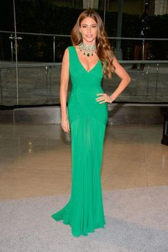Sofia Vergara is stunning in a green dress and coordinating statement necklace, plus earrings,  at the 2013 CFDA Awards.