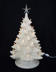 Dreaming of a White Christmas? White Christmas Ceramic Christmas Tree with white base, music box, and over 50 white (clear) lights to shine for Christmas Love, Christmas Themes, Christmas Crafts, Christmas Decorations, Holiday Decor, Vintage Decorations, Holiday Ideas, Church Decorations, Christmas Jesus