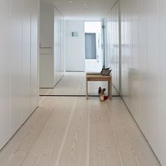 Hallway with floor to ceiling mirror and 30 centimeters wide Dinesen GrandDouglas floor boards treated with lye and white soap #dinesen #dinesengranddouglas #granddouglas #floorboards #hallway #floortoceiling #mirror #interior #interiordesign