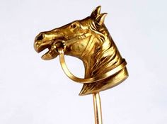Horse head pin by ?Fix? A stick pin of a bridled horses head by Bijoux Fix. The reverse marked ?FIX? and the pin stamped. FIX (Bijoux FIX) was founded in 1823 and is credited to have invented the laminated gold technique often known today as rolled gold. Lamination bonds a thick layer of gold onto a base metal whereas plating adds a thin layer of gold normally by a chemical or electrolytic process. FIX became a generic name used when speaking of the finest quality gold overlayed products.