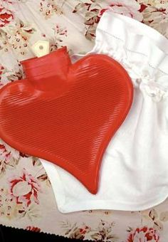 """Warm Heart"" Hot Water Bottle. It will warm your heart and your ache...tucked in a pristine linen cover. Made just as the old fashioned ones that have provided comfort for generations. Soft Rubber. 8""."