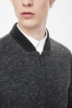 This jacket is made from a wool-blend with a speckled finish. A regular fit, it has in- and outside pockets, a sporty ribbed neckline and a matte black zip fastening along the front.
