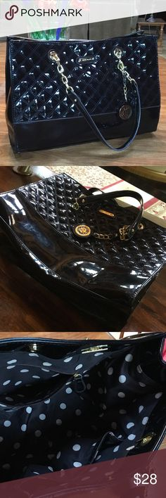 Anne Klein Shiney black quilted large purse.  In great shape other than some smudges and minor scuffs that would be the case with a gently used patent purse.  No rips, tears or damage.  Please see photo of wear to handle area where you would hold the straps.  Anne Klein purse charm attached.  Man made materials. Anne Klein Bags